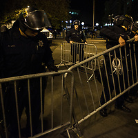 OAKLAND, CA - NOVEMBER 14, 2011: Police officers form a barricade, preparing to break down the Occupy encampment at Frank H. Ogawa Plaza. The City of Oakland cited health code violations and concerns as their reason for breaking down the encampment.