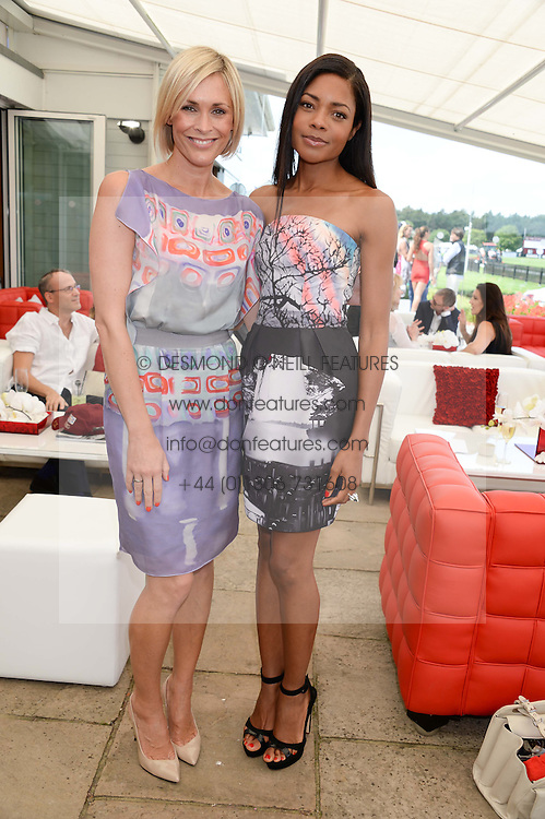Left to right, JENNI FALCONER and NAOMIE HARRIS at the Audi International Polo at Guards Polo Windsor Great Park, Egham, Surrey on 28th July 2013.