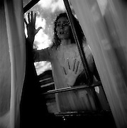 Woman Peering Thru Window of Heritage Mansion near Maitland, NSW, Australia