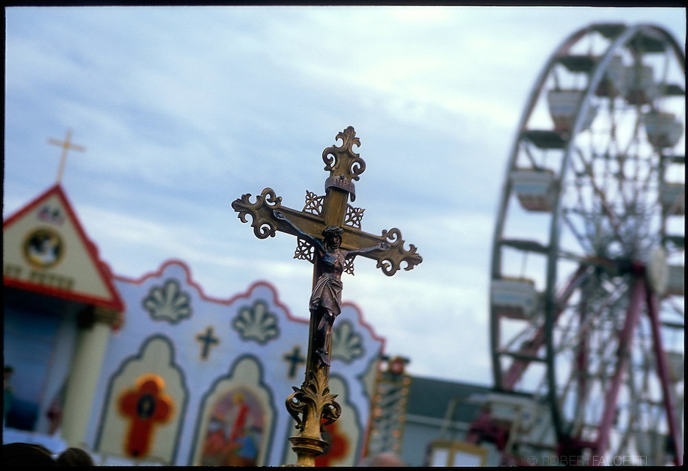 GLOUCESTER, MA- JUNE 29, 2003:  A Catholic crucifix is displayed prior to the start of Mass in St. Peter's Square during the annual celebration paying homage to St. Peter, the patron saint of fishermen in Gloucester, MA. The festa takes place on the weekend closest to the Feast Day of St. Peter, June 29. .(Photo by Robert Falcetti) . .