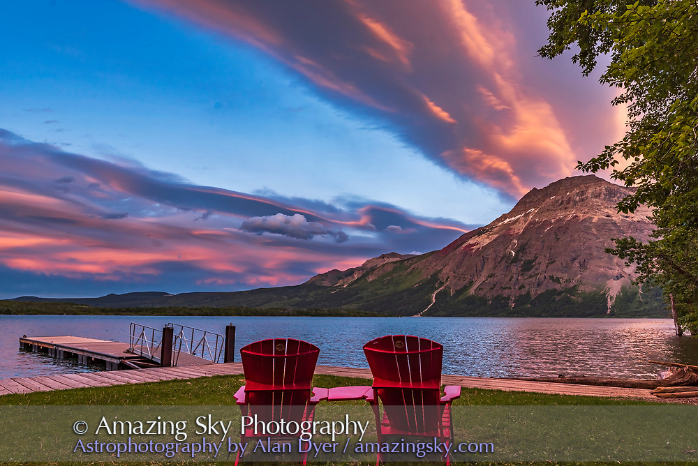 The iconic Red Chairs of Parks Canada in the sunset light at Middle Waterton Lake in Waterton Lakes National Park, on June 17, 2017. Vimy Peak is at right. <br /> <br /> This was taken as part of a 200-frame time-lapse.