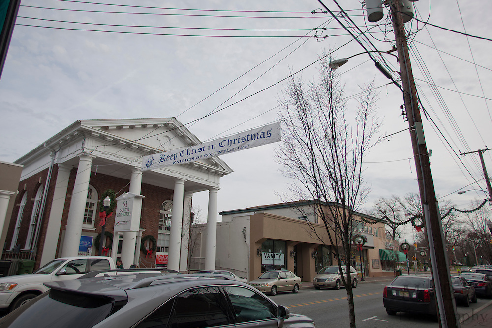 "The ""Keep Christ is Christmas Banner""  sponsored by Knights of Columbus 6247 is attached on one side to a telephone pole and to private property at 51 South Broadway on the other side hangs over Broadway in downtown Pitman, NJ on Thursday December 15, 2011. (photo / Mat Boyle)"