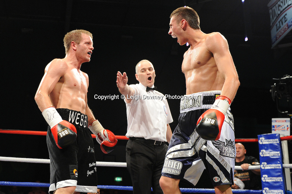 The referee intervenes when both Prince Arron (silver/blue shorts) exchange words when a round bell sounded at Medway Park, Gillingham,13th May 2011. Frank Maloney Promotions. Photo credit © Leigh Dawney.