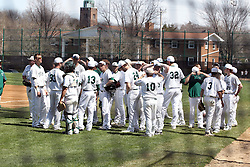 14 April 2013:  Illinois Wesleyan Titan Baseball team during an NCAA division 3 College Conference of Illinois and Wisconsin (CCIW) Baseball game between the Elmhurst Bluejays and the Illinois Wesleyan Titans in Jack Horenberger Stadium, Bloomington IL