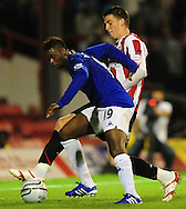 London - Tuesday, 21st September, 2010: Michael Spillane of Brentford and Magaye Gueye of Everton during the Carling Cup 3rd Round match at Griffin Park, London...Pic by: Alex Broadway/Focus Images
