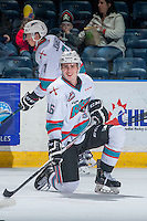 KELOWNA, CANADA - FEBRUARY 27: Kole Lind #16 of Kelowna Rockets stretches on the ice during warm up against the Spokane Chiefs on February 27, 2016 at Prospera Place in Kelowna, British Columbia, Canada.  (Photo by Marissa Baecker/Shoot the Breeze)  *** Local Caption ***  Kole Lind;