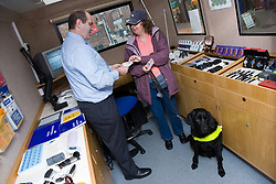 Resource Officer advising a woman with severe sight impairment who is visiting the mobile resource unit,