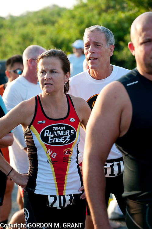 Mary Frances and Tom Horan of Lake Ronkonkoma before the start of the swim section of the Montauk Point Lighthouse Sprint Triathlon at Gin Beach in Montauk. (July 18, 2010)