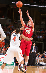 Maryland forward Dave Neal (35) shoots a jump shot over Virginia guard Calvin Baker (4).  The Virginia Cavaliers defeated the Maryland Terrapins 68-63 at the John Paul Jones Arena on the Grounds of the University of Virginia in Charlottesville, VA on March 7, 2009.