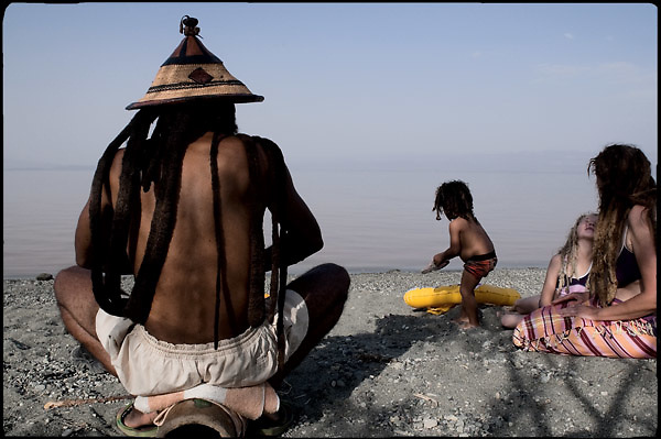 "A french family, rasta faith, enjoy a sunny day at Lake Langano, on the road to Shashemene, south Ethiopia, on thursday, March 20 2008......""Shashamene or Shashemene (ethiopian name), located in the Oromia Region of Ethiopia, is ""the place"", the ancestral homeland. For the whole Rastafarians repatriation to Africa or to Zion or to the Promise Land is the first goal. Rastas assert that ""Mount Zion"" is a place promised by Jah and they  claim themselves to represent the real Children of Israel in modern times. During the last years of the 40's, Emperor Haile Selassie I, considerated from that movement incarnation of God, donated 500 acres of his private land to members and other settlers from Jamaica including other parts of the Caribbean..The Rastafarian settlement in Shashamane was recently reported to exceed two hundred families. In January 2007 it organized an exhibition and a bazaar in the city. It was also reported recently prior to the Ethiopian Millennium that various pro-Ethiopian World Federation groups, consisting of indigenious Ethiopians and Rastafarians, have given support to one of many five year plans proposed for sustainable development of Shashamene, Ethiopia."""