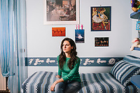 NAPLES, ITALY - 26 MAY 2018: Giada Gramanzini, a 29-year-old unemployed university graduate who moved back in with her retired parents, poses for a portrait in her childhood bedroom in Naples, Italy, on May 26th 2018.<br /> <br /> Credit: Gianni Cipriano for The Wall Street Journal<br /> <br /> Slug: GENDIVIDE<br /> <br /> Giada Gramanzini hasn't found a job since deciding last year not to renew a three-month contract as a fulltime receptionist that paid her 400 euros a month, or about $2.80 an hour. She sent out about 70 resumes in the past six months in search of a job where she can put her degree in foreign languages to work.<br /> <br /> The Italian economy last year grew at its fastest rate since 2010, but the improvement hasn't trickled down to millions of people in their 20s and 30s, leaving a yawning generation gap with their baby boomer parents.<br /> <br /> Giada Gramanzini hasn't found a job since deciding last year not to renew a three-month contract as a fulltime receptionist that paid her 400 euros a month, or about $2.80 an hour. She sent out about 70 resumes in the past six months in search of a job where she can put her degree in foreign languages to work.<br /> <br /> The Italian economy last year grew at its fastest rate since 2010, but the improvement hasn't trickled down to millions of people in their 20s and 30s, leaving a yawning generation gap with their baby boomer parents.