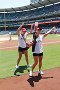 ANAHEIM, CA - JULY 21:  Strike Force members of the Los Angeles Angels of Anaheim fire up the fans before the game against the Texas Rangers on July 21, 2011 at Angel Stadium in Anaheim, California. The Angels won the game in a 1-0 shutout. (Photo by Paul Spinelli/MLB Photos via Getty Images)