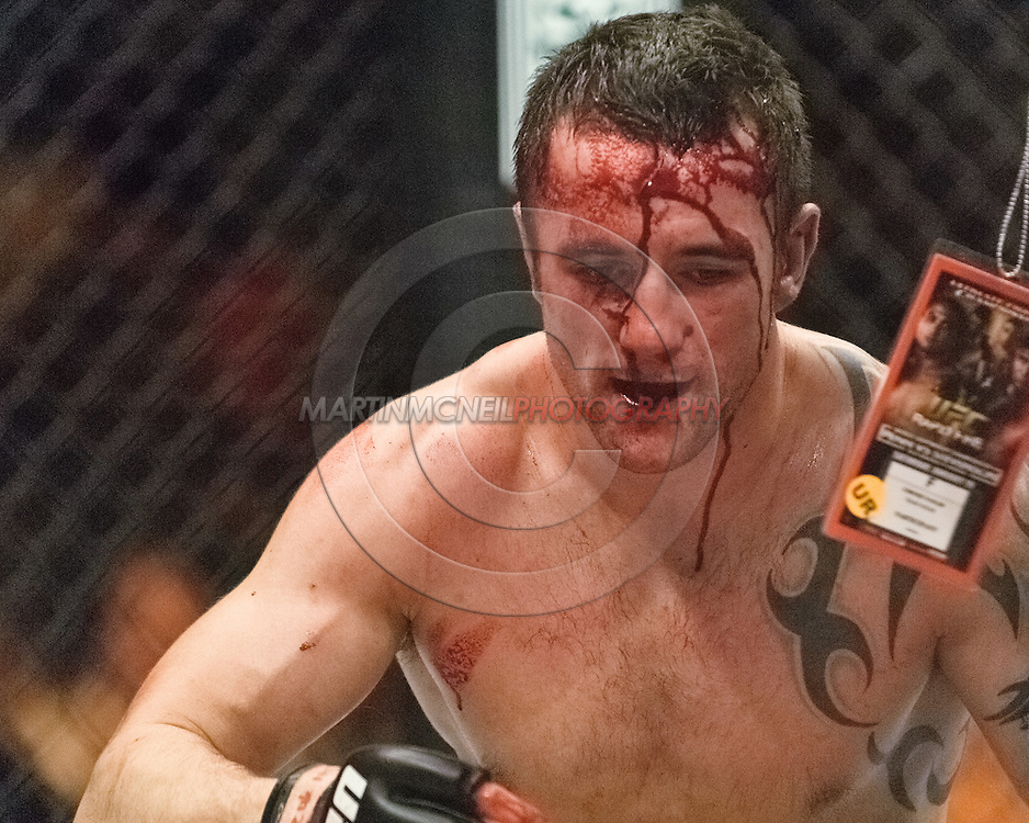 """NEWCASTLE, ENGLAND, UNITED KINGDOM, JANUARY 19 2008: A bloodied Paul Talyor posts up off the canvas between rounds during """"UFC 80: Rapid Fire"""" inside the Metro Radio Arena in Newcastle, England on January 19, 2008."""