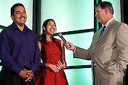 Jazmin Tule, an intern at ZixCorp, and her father Enrique Tule are interviewed by Dallas Mayor Mike Rawlings during the Mayor's Intern Fellows Program closing celebrations at the Hyatt Regency in Dallas on Friday, August 9, 2013. (Cooper Neill/Special Contributor)