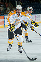 KELOWNA, CANADA - OCTOBER 25: Colton Waltz #5 of Brandon Wheat Kings skates with the puck during warm up against the Kelowna Rockets on October 25, 2014 at Prospera Place in Kelowna, British Columbia, Canada.  (Photo by Marissa Baecker/Shoot the Breeze)  *** Local Caption *** Colton Waltz;
