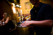 Wine is carried to a table at the 58 Degrees and Holding Company wine bar in Sacramento, California.