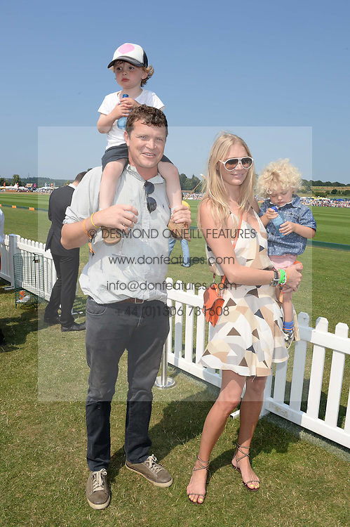 JACK KIDD  with his son JESSE KIDD, JODIE KIDD and her son INDIO VIANINI KIDD at the Veuve Clicquot Gold Cup, Cowdray Park, Midhurst, West Sussex on 21st July 2013.