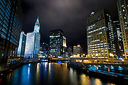 View of Chicago River and the city lights of the skyline at night