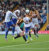 Nathan Cameron heads in burys opener during the Sky Bet League 1 match between Bury and Port Vale at Gigg Lane, Bury, England on 19 September 2015. Photo by Mark Pollitt.