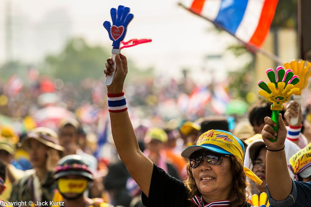 "09 DECEMBER 2013 - BANGKOK, THAILAND:  Thai anti-government protestors celebrate the news that Prime Minister Yingluck Shinawatra dissolved the Thai parliament. Thai Prime Minister Yingluck Shinawatra announced she would dissolve the lower house of the Parliament and call new elections in the face of ongoing anti-government protests in Bangkok. Hundreds of thousands of people flocked to Government House, the office of the Prime Minister, Monday to celebrate the collapse of the government after Yingluck made her announcement. Former Deputy Prime Minister Suthep Thaugsuban, the organizer of the protests, said the protests would continue until the ""Thaksin influence is uprooted from Thailand."" There were no reports of violence in the protests Monday.     PHOTO BY JACK KURTZ"