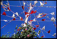 Flags and flowers adorn Maypole at Padstow's May Day festival; Cornwall, England.