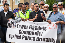 London, UK. 12 July, 2019. A member of the local community remonstrates with John Biggs, the Labour Mayor of Tower Hamlets (out of picture), during a protest close to the site where Younis Bentahar, aged 38, was violently arrested by Metropolitan Police officers on 10th July following a 5-stage warning. The incident, during which Mr Bentahar appeared to be having a seizure, has since been referred to the Metropolitan Police's Central East Command Professional Standards Unit after a video of the arrest went viral on social media. Mr Bentahar was filmed being struck with handcuffs and pinned down by police officers after he had stopped on a single yellow line with a disabled badge displayed and ignored the five-stage warning.