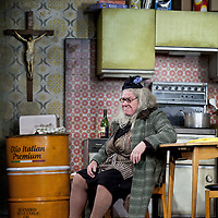 Gregor Fisher as 'Yer Granny' who is eating the family out of house and home.<br /> <br /> Yer Granny - a new production by The National Theatre of Scotland opens at the Beacon arts Centre, Greenock, Scotland.<br /> <br /> <br /> Based on La Nona by Roberto Cossa<br /> In a new version by Douglas Maxwell<br /> Directed by Graham McLaren<br /> <br /> <br /> Picture by Drew Farrell<br /> Tel : 07721-735041<br /> Image offered on a speculative basis.<br /> <br /> Yer Granny is a riotous new comedy about a diabolical 100-year-old granny who&rsquo;s literally eating her family out of house and home. She&rsquo;s already eaten their fish and chip shop into bankruptcy and now she&rsquo;s working her way through their kitchen cupboards, pushing the Russo family to desperate measures just to survive beyond 1977.<br /> <br /> As proud head of the family, Cammy is determined that The Minerva Fish Bar will rise again and that family honour will be restored &ndash; and all in time for the Queen&rsquo;s upcoming Jubilee visit. But before Cammy&rsquo;s dream can come true and before Her Maj can pop in for a chat, a single sausage and a royal seal of approval, the family members must ask themselves how far they will go to solve a problem like Yer Granny.<br /> <br /> Adapted from the smash-hit Argentinian comedy classic La Nona, the cast of Yer Granny features some of Scotland&rsquo;s best-loved performers, including Gregor Fisher in the title role, alongside Paul Riley (Still Game), Jonathan Watson (Only An Excuse?), Maureen Beattie (Casualty), Barbara Rafferty (Rab C Nesbitt), Brian Pettifer (The Musketeers) and Louise McCarthy (Mamma Mia!, West End).<br /> <br /> Performance dates :<br /> The Beacon Arts Centre, Greenock<br /> 19/05/2015&nbsp;-&nbsp;21/05/2015 <br /> <br /> King's Theatre, Glasgow<br /> 26/05/2015&nbsp;-&nbsp;30/05/2015 <br /> <br /> King's Theatre, Edinburgh<br /> 02/06/2015&nbsp;-&nbsp;06/06/2015 <br /> <br /> Eden Court, Inverness<br /> <br /> Lyric Theatre, Belfast<br /> 23/06/2015&nbsp;-&nbsp;27/06/2015 <br /> <br /> Dundee Rep Theatre<br /> 30/06/2015&nbsp;-&nbsp;04/07/2015