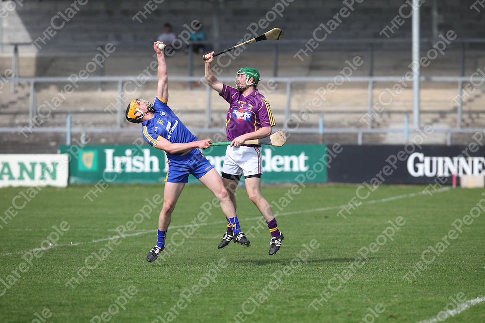 Clare's John Conlon and Wexfords Matthew O Hanlon in action in Cusack Park on Sunday.<br /> Pic. Brian Arthur/ Press 22.