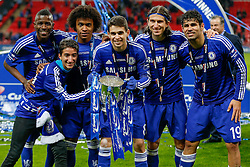 Jose Mourinho Jr (2L) (son of the Chelsea Manager) poses with Ramires, Willian, Oscar, Filipe Luis and Diego Costa after Chelsea win the Capital One Cup Final - Photo mandatory by-line: Rogan Thomson/JMP - 07966 386802 - 01/03/2015 - SPORT - FOOTBALL - London, England - Wembley Stadium - Chelsea v Tottenham Hotspur - Capital One Cup Final.