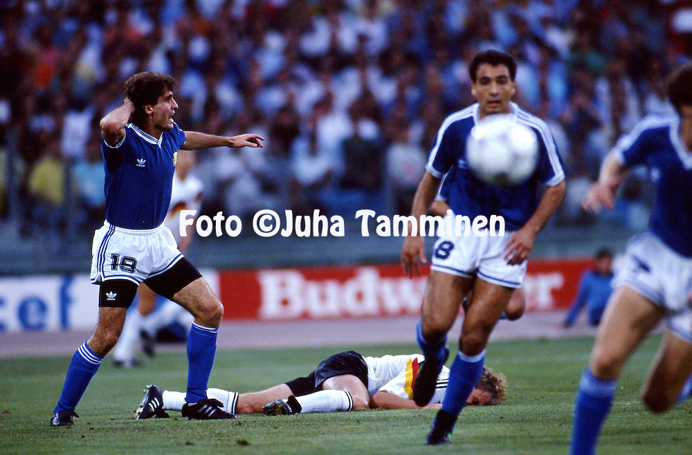 FIFA World Cup - Italia 1990<br /> Stadio Olimpico, Rome, Italy.<br /> Final Argentina v West Germany.<br /> Oscar Ruggeri (Argentina) holds his head, while Rudi V&ouml;ller (Germany) has his face on the grass.
