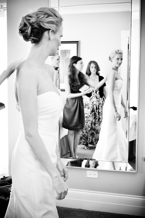 Kelly's bridesmaids help her get ready at the Elysian Hotel in Chicago, IL