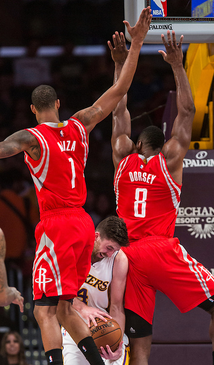 Los Angeles Lakers forward Ryan Kelly (4) defended by Houston Rockets forward Trevor Ariza (1) and center Joey Dorsey (8) during their NBA game at Staples Center in Los Angeles, California on January 25, 2015 . Rockets defeated Lakers 99-87. (Photo by Ringo Chiu/PHOTOFORMULA.com)