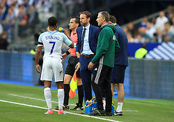 England manager Gareth Southgate speaks with Raheem Sterling during the International Friendly at the Stade de France, Paris.