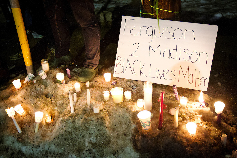 during a candlelight vigil on Williamson Street on Sunday night for Tony Robinson, March 8, 2015. Robinson an unarmed black teen shot on Friday by Madison Police inside his home. REUTERS/Ben Brewer (UNITED STATES)