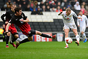 Milton Keynes Dons midfielder Ben Reeves (10) shoots under pressure from Coventry City defender Chris Stokes (3) during the EFL Sky Bet League 1 match between Milton Keynes Dons and Coventry City at stadium:mk, Milton Keynes, England on 18 March 2017. Photo by Dennis Goodwin.