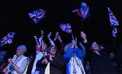 © Licensed to London News Pictures.22/08/15<br /> Castle Howard, North Yorkshire, UK. <br /> <br /> People dance and wave flags as they attend the 25th anniversary of the Castle Howard Proms event near York. The theme of the event this year is a commemoration of the 75th anniversary of the Battle of Britain and the 70th anniversary of VE day and brings an evening of classic musical favourites celebrating Britishness to the lawns of Castle Howard.<br /> <br /> Photo credit : Ian Forsyth/LNP