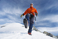 Mountain climber hiking on snowy slope