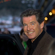 Pierce Brosnan  of James Bond 007 fame, smiles for fans and media after a reception at the Volkswagen on Main Street openhouse on old main street of Park City on the second day of the Sundance Film Festival Friday, Jan. 21, 2005 in Park City, Utah. August Miller/ Deseret Morning News DIGITAL PHOTOGRAPH