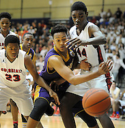 SPLYM16P<br /> Roman Catholic's Paul Newman (center) loses control of a rebound as Plymouth Whitemarsh's Ahmin Williams #23 and Naheem McLeod #44 defend in the first quarter of a semifinal playoff game Monday March 15, 2016 at Council Rock South High School in Richboro, Pennsylvania. (William Thomas Cain/For The Inquirer)