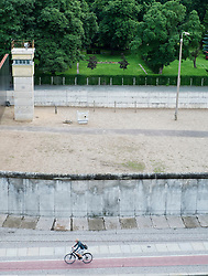 Section of original Berlin Wall watchtower and death strip at Bernauer Strasse in Berlin Germany