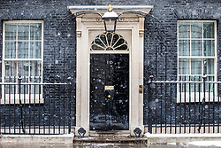 © Licensed to London News Pictures. 28/02/2018. London, UK. 10 Downing Street as heavy snow falls in central London. Severe weather is set to continue as the 'Beast from the East' brings freezing Siberian air to the UK. Photo credit: Rob Pinney/LNP