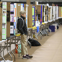 Starkville Christian High School student Ben Smith, 13, stands all alone on his isle as he waits for Friday's State Science Fair to get started at Northeast Community College.