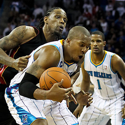 November 5, 2010; New Orleans, LA, USA; Miami Heat power forward Udonis Haslem (40) fouls New Orleans Hornets power forward David West (30) on the inbound pass during the fourth quarter at the New Orleans Arena. The Hornets defeated the Heat 96-93. Mandatory Credit: Derick E. Hingle