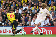 Manchester United Midfielder Marouane Fellaini takes on Watford midfielder Etienne Capoue (29) during the Premier League match between Watford and Manchester United at Vicarage Road, Watford, England on 15 September 2018.