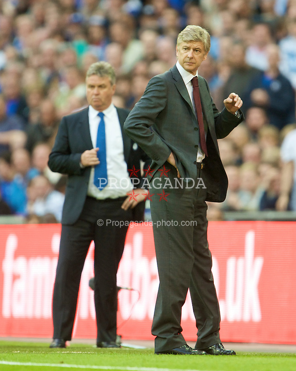 LONDON, ENGLAND - Saturday, April 18, 2009: Arsenal's manager Arsene Wenger and Chelsea's manager Guus Hiddink during the FA Cup Semi-Final match at Wembley. (Photo by: David Rawcliffe/Propaganda)