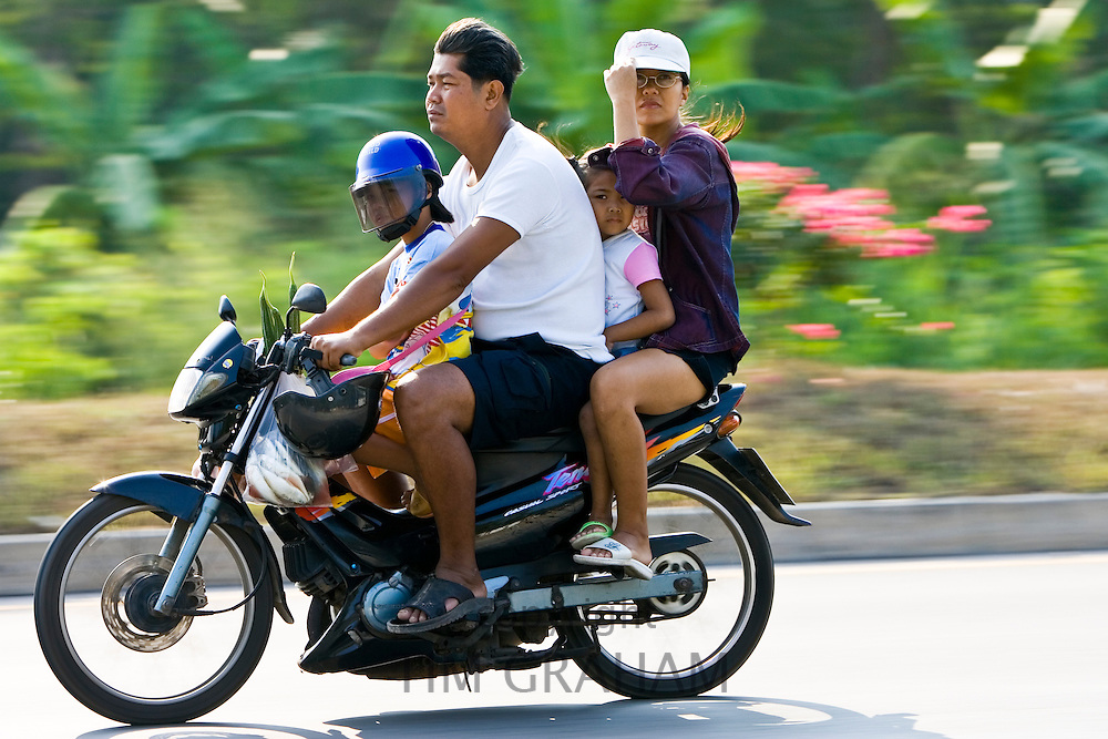 Family travel on a motorcyle, Bangkok, Thailand