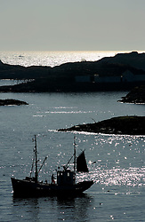 NORWAY LOFOTEN 27MAR07 - Silhouette of a Lofoten fishing boat leaving outside Henningsvaer on the Lofoten islands...jre/Photo by Jiri Rezac..© Jiri Rezac 2007..Contact: +44 (0) 7050 110 417.Mobile:  +44 (0) 7801 337 683.Office:  +44 (0) 20 8968 9635..Email:   jiri@jirirezac.com.Web:    www.jirirezac.com..© All images Jiri Rezac 2007 - All rights reserved.