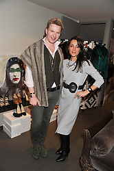 HENRY CONWAY and ELLI NOROLOZIAN at a private sales evening for Atelier Mayer held at 18 Horbury Crescent, London W11 on 22nd November 2011.