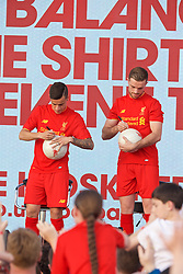 LIVERPOOL, ENGLAND - Monday, May 9, 2016: Liverpool's Philippe Coutinho Correia and captain Jordan Henderson at the launch of the New Balance 2016/17 Liverpool FC kit at a live event in front of supporters at the Royal Liver Building on Liverpool's historic World Heritage waterfront. (Pic by David Rawcliffe/Propaganda)