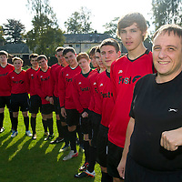 Scone Thistle U19's football team manager Gerry Scott who works for Scotrail with some of his players wearing their new strips provided by Scotrail's parent company the First Group....23.09.12<br /> Picture by Graeme Hart.<br /> Copyright Perthshire Picture Agency<br /> Tel: 01738 623350  Mobile: 07990 594431